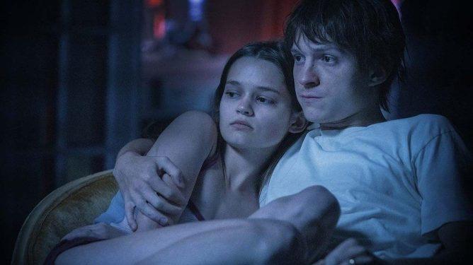 Ciara Bravo and Tom Holland holding each other dearly as seen in Cherry written by Jessica Goldberg and Angela Russo-Ostot.