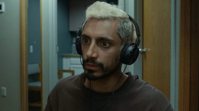 Riz Ahmed learning to hear with headphones as seen in the 6 time Oscar nominated film Sound of Metal.
