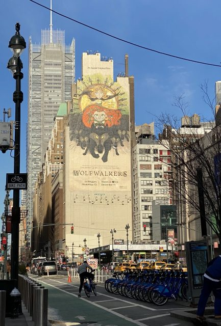 A giant mural poster for the Oscar nominated film Wolfwalkers painted on the side of a Manhattan building in New York.