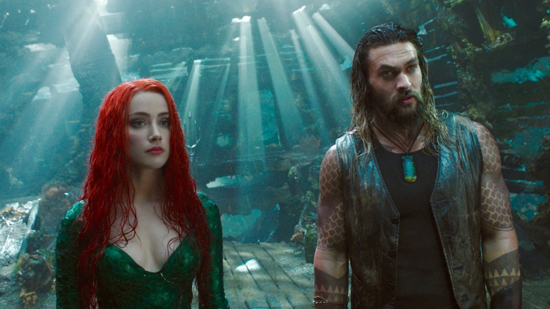 Amber Heard and Jason Momoa underwater as seen in Aquaman, both returning to film the sequel Aquaman 2 summer 2021.