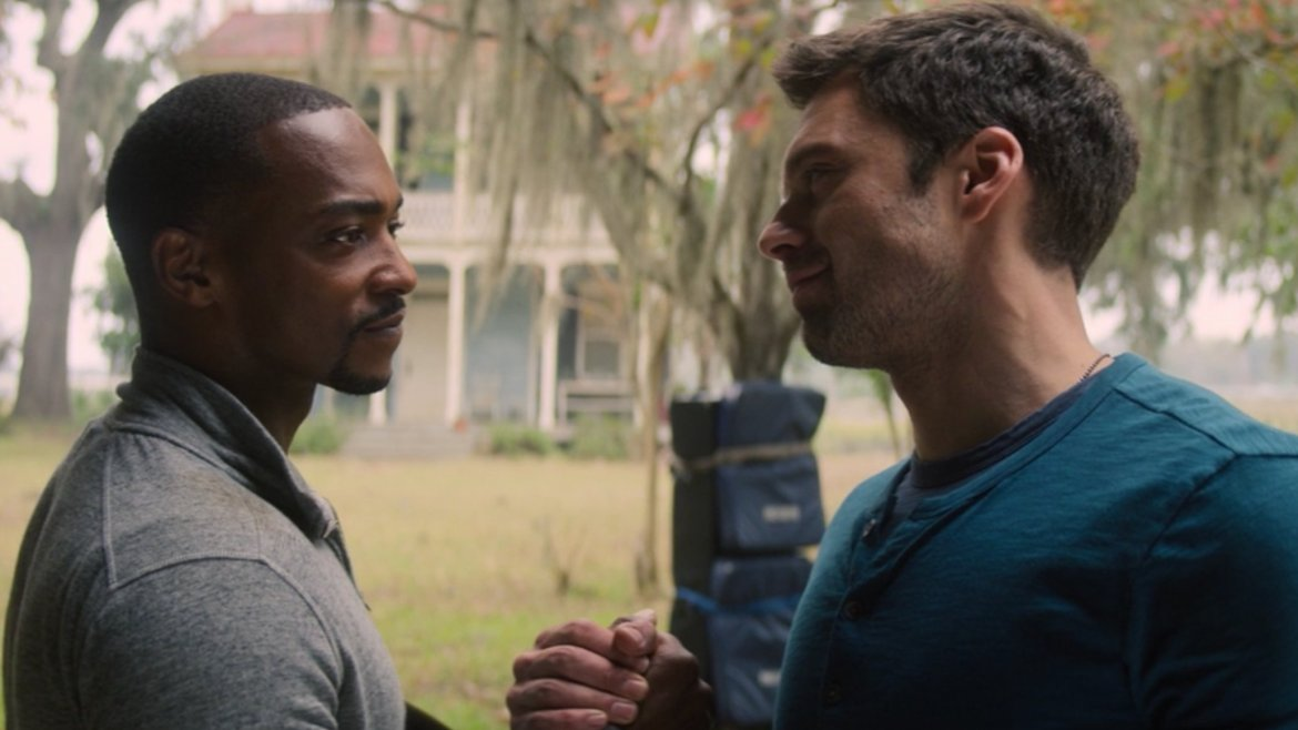 Anthony Mackie and Sebastian Stan coming together to shake hands as seen in episode 5 of The Falcon and the Winter Soldier.