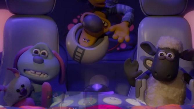 Shaun the Sheep, Lu-la, and Bitzer the dog riding a space ship as seen in the Oscar-nominated film Shaun the Sheep: Farmageddon.