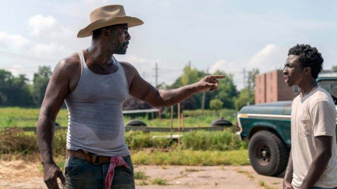 Idris Elba and Caleb McLaughlin on an urban ranch as seen in the Netflix film Concrete Cowboy directed by Ricky Staub.