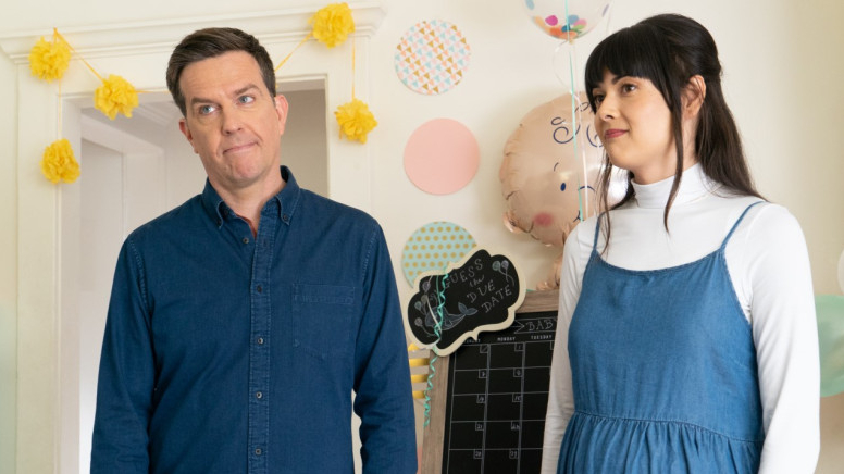 Ed Helms and Patti Harrison standing next to each other in a baby's room as seen in the new dramatic comedy Together Together.
