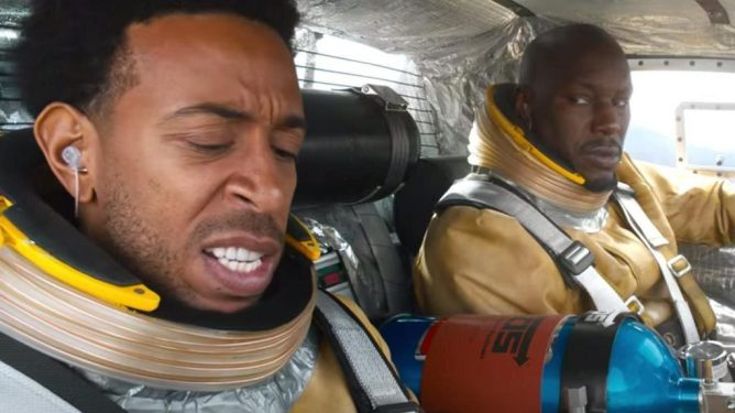 Ludicrous and Tyrese look terrified as they prepare for liftoff into space wearing cheap astronaut suits as seen in F9.