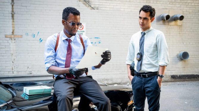 Chris rock and Max Minghella as detectives investigating a Jigsaw crime scene in the new film Spiral: From the Book of Saw.