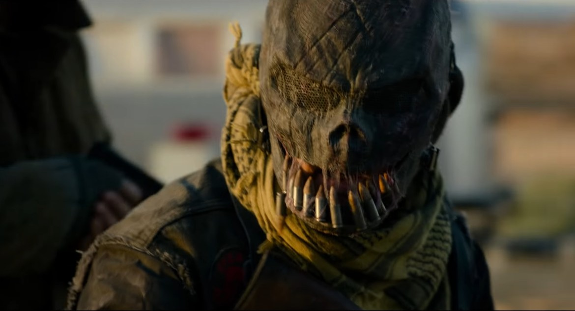 A purger with a scarecrow-like mask with bullets as teeth as seen in THE FOREVER PURGE produced by Blumhouse and JASON BLUM.