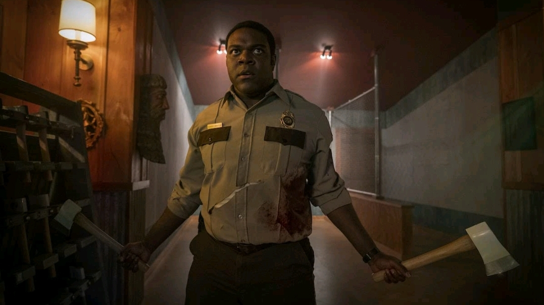 Sam Richardson with two silver axes in hand as seen in the new Horror Comedy WEREWOLVES WITHIN.