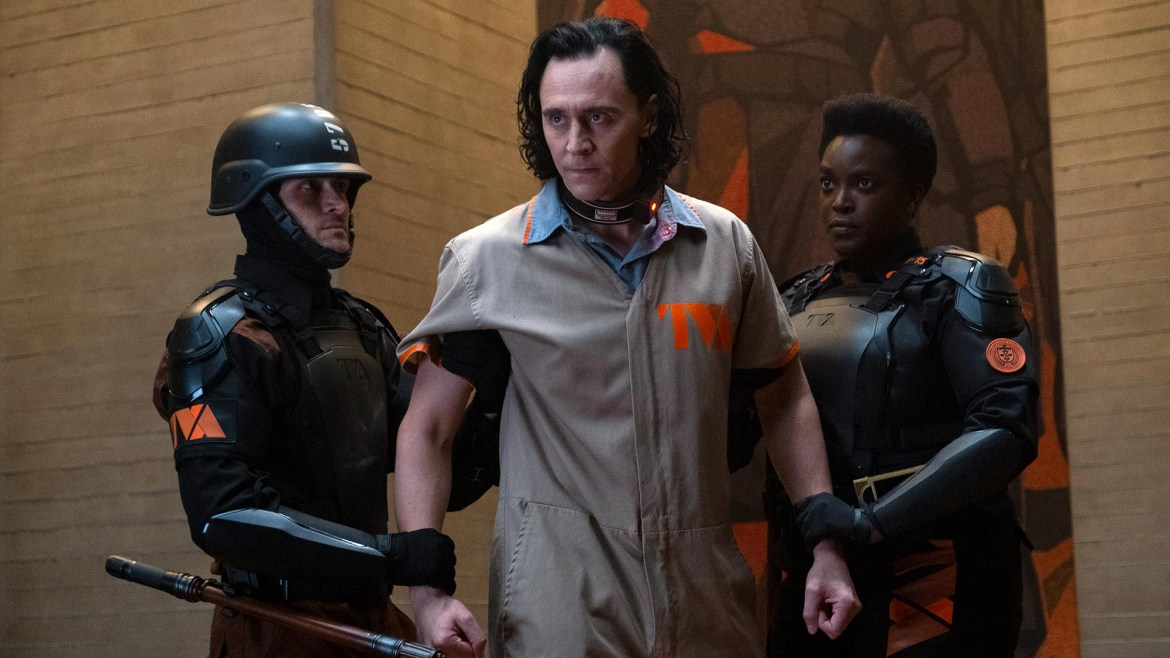 Hunter B-15 played by Wunmi Mosaku taking Loki played by Tom Hiddleston to trial for his crimes at the TVA as seen in the series premier of Loki on Disney+.