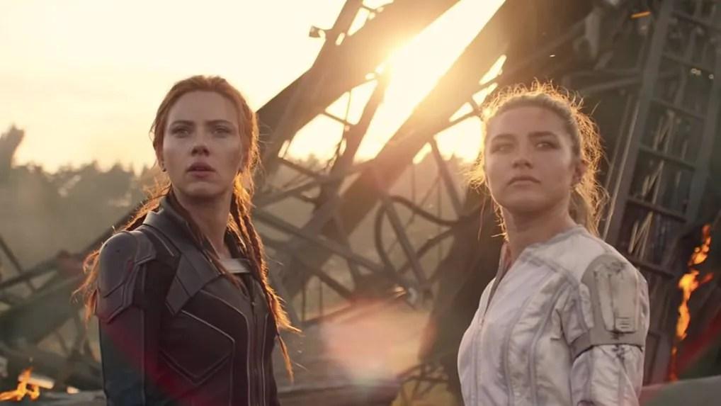 Scarlett Johansson as Natasha Romanoff next to Florence Pugh as Yelena Belova in a battlefield as seen in Marvel's BLACK WIDOW written by Eric Pearson.