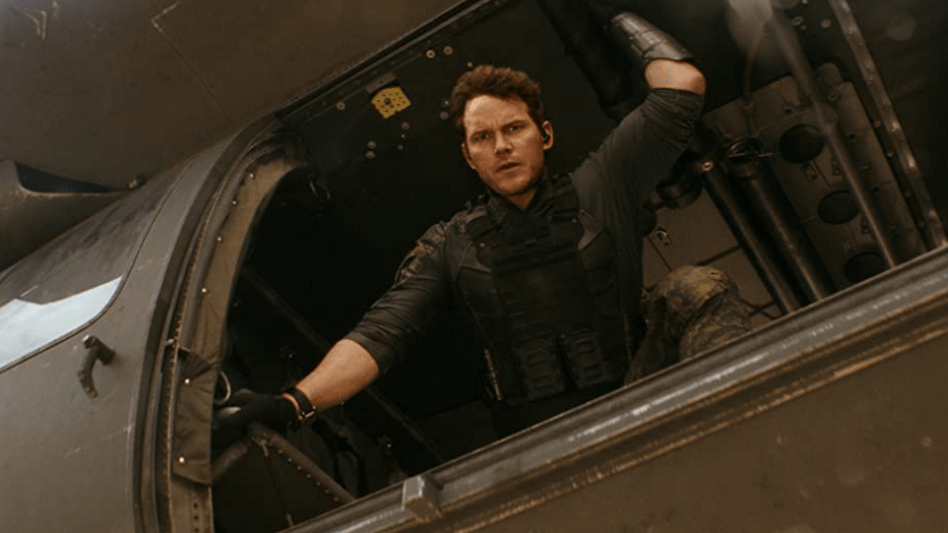 Chris Pratt looking down from a military helicopter as seen in the new sci-fi film THE TOMORROW WAR on Prime Video.