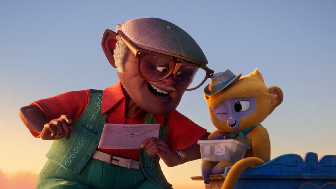 Vivo the yellow Kinkajou voiced by Lin-Manuel Miranda writing a love letter with his human partner Andres voiced by Juan de Marcos Gonzalez in Cuba as seen in the new Sony animated film to hit Netflix VIVO.