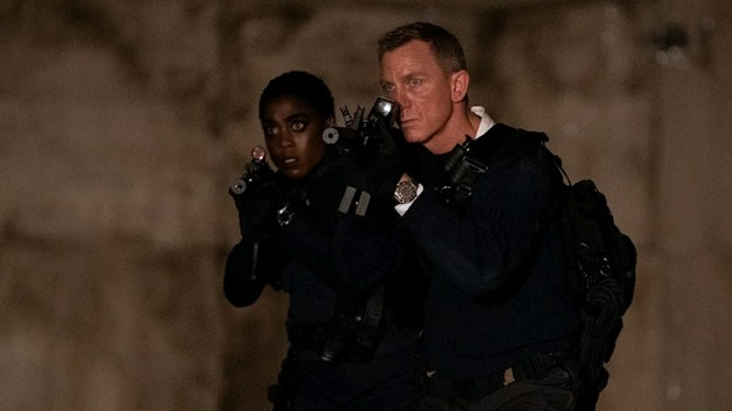 Lashana Lynch and Daniel Craig infiltrating a secret island base in NO TIME TO DIE directed by Cary Fukunaga.