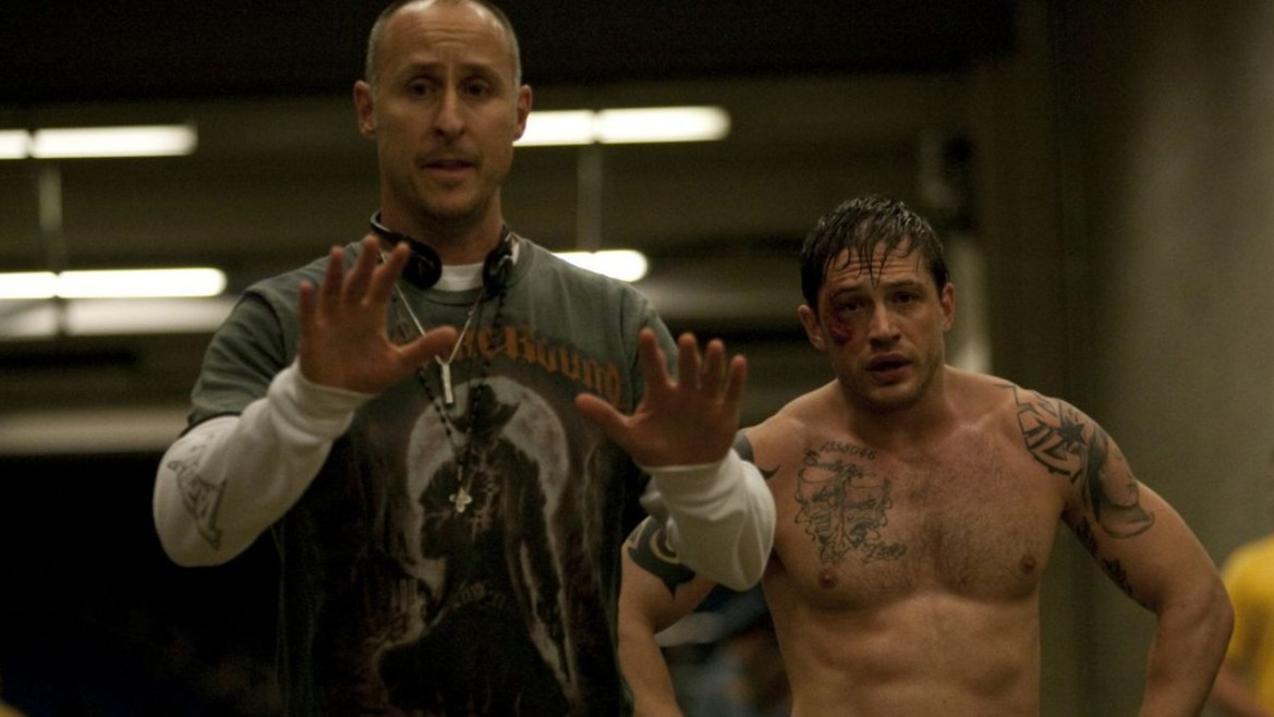 Director Gavin O'Connor on the set of WARRIOR with Tom Hardy bruised and bleeding in full MMA gear.