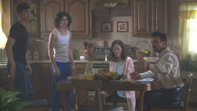 Jonah Hauer-King, Lucius Hoyos, Naomi Watts and Frank Grillo gather around the family table in THIS IS THE NIGHT directed by James DeMonaco