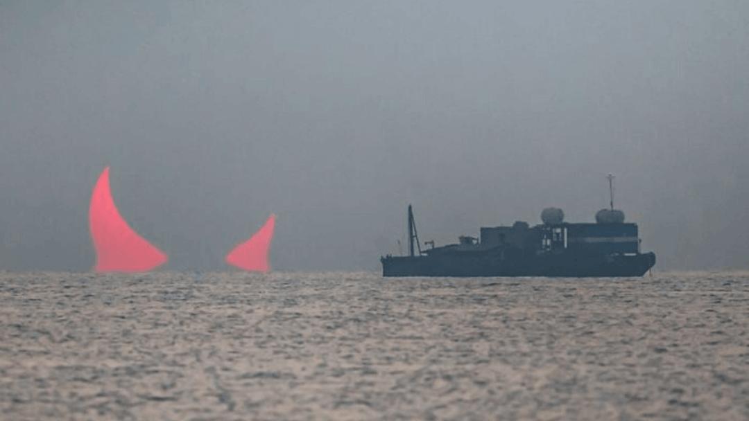 Photographer captures rare Devil Horns solar eclipse over the Persian Gulf