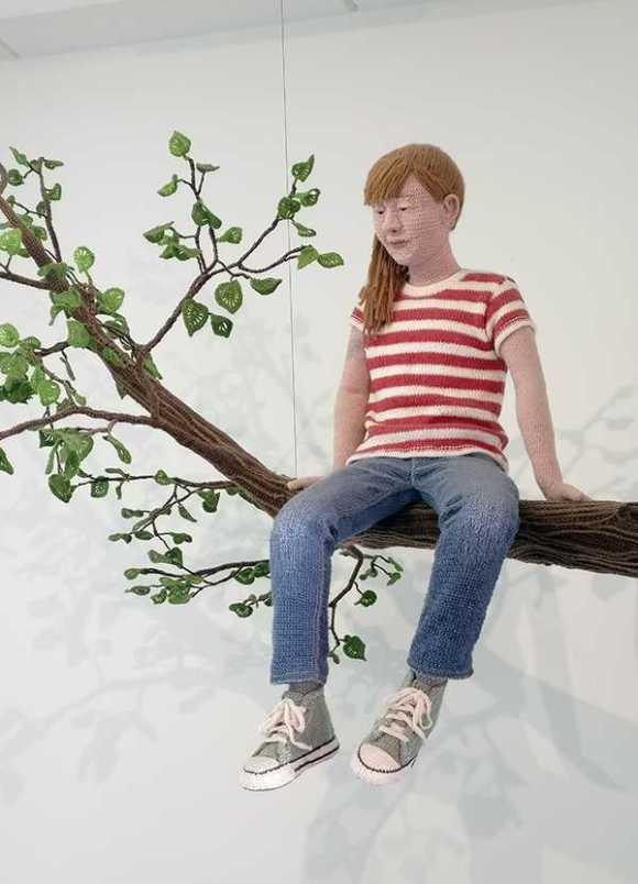 Yarn artist Liisa Hietanen makes human embroidered figures