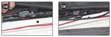 Kabel zjeżdża do progu samochodu i rozciąga się do pnia uszczelki w progu.