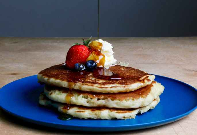 pancakes with strawberry blueberries and maple syrup