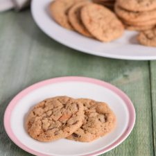 Best Butterfinger Peanut Butter Cookies on a plate with more cookies in the background