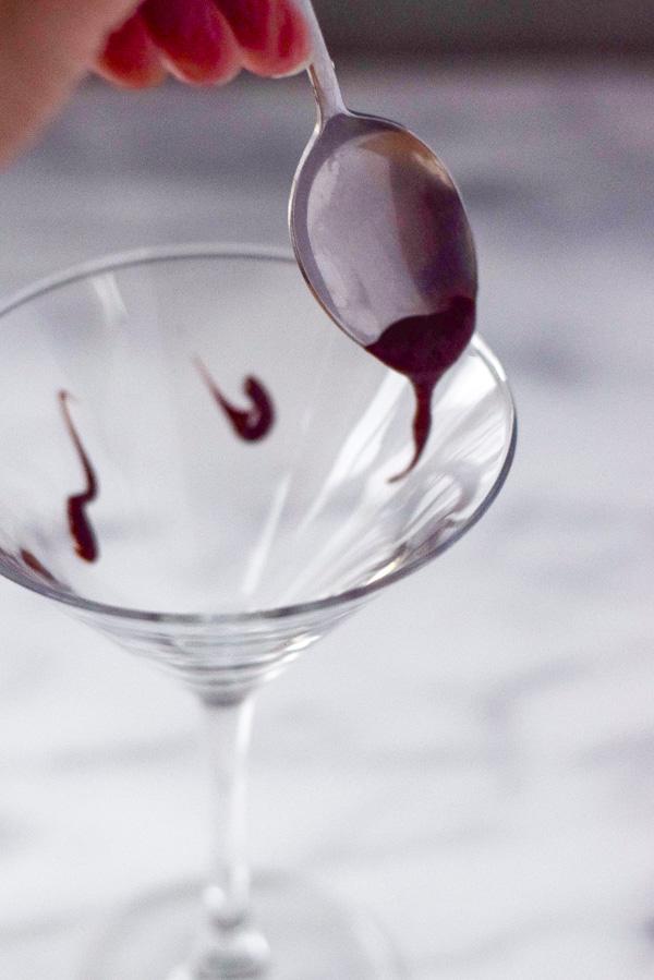 Nutella dribbled into martini glass for chocolate martini