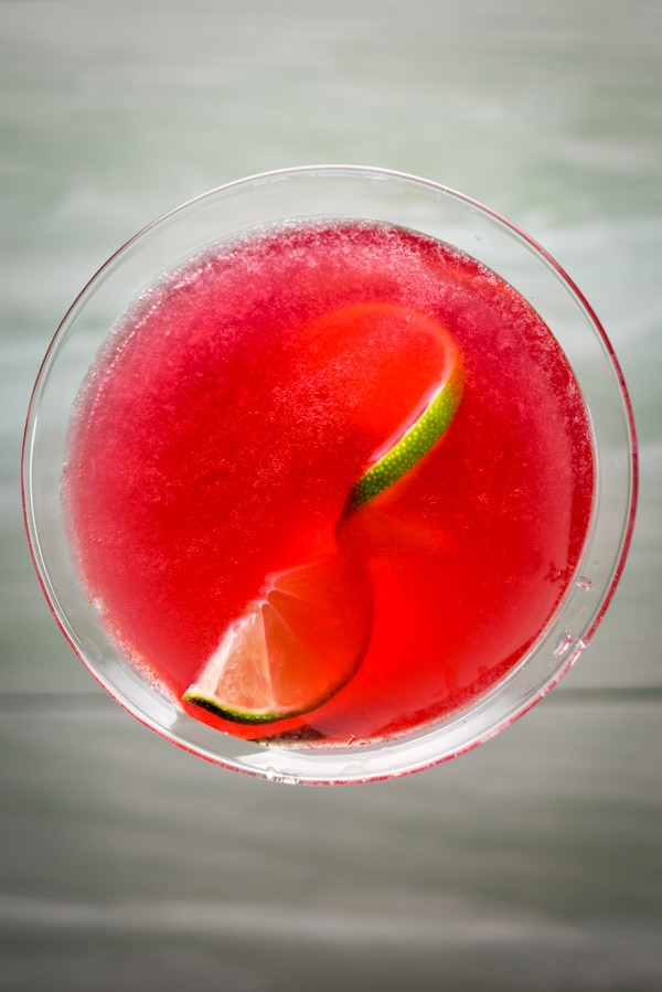 Overhead view of the red drink with lime in it