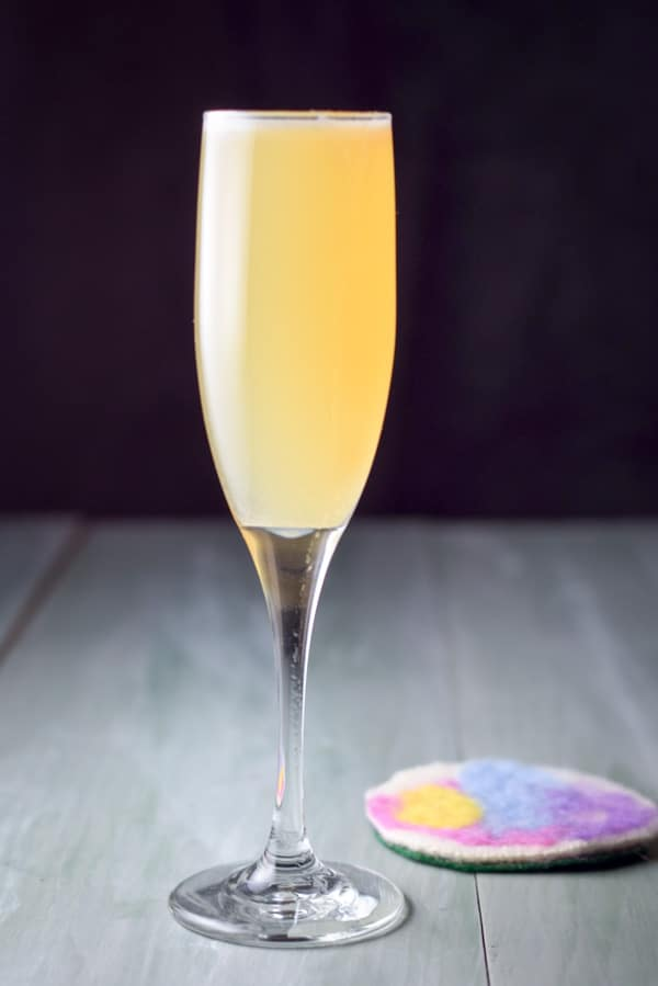 Vertical view of the champagne glass filled with an amber drink