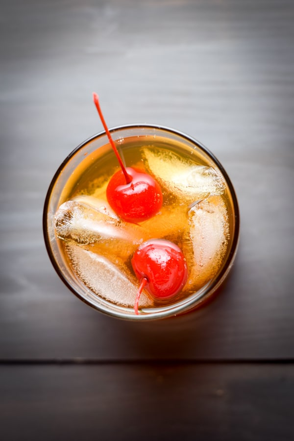 Overhead view of a manhattan with two red cherries in it