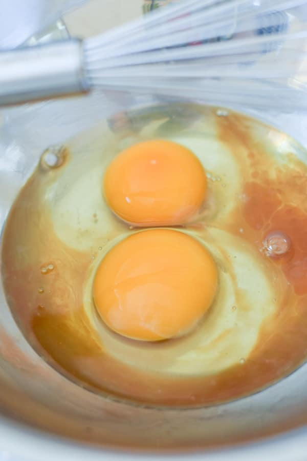 eggs and vanilla to be whisked together in a metal bowl