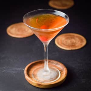 Rob Roy in a martini glass with a cherry in it