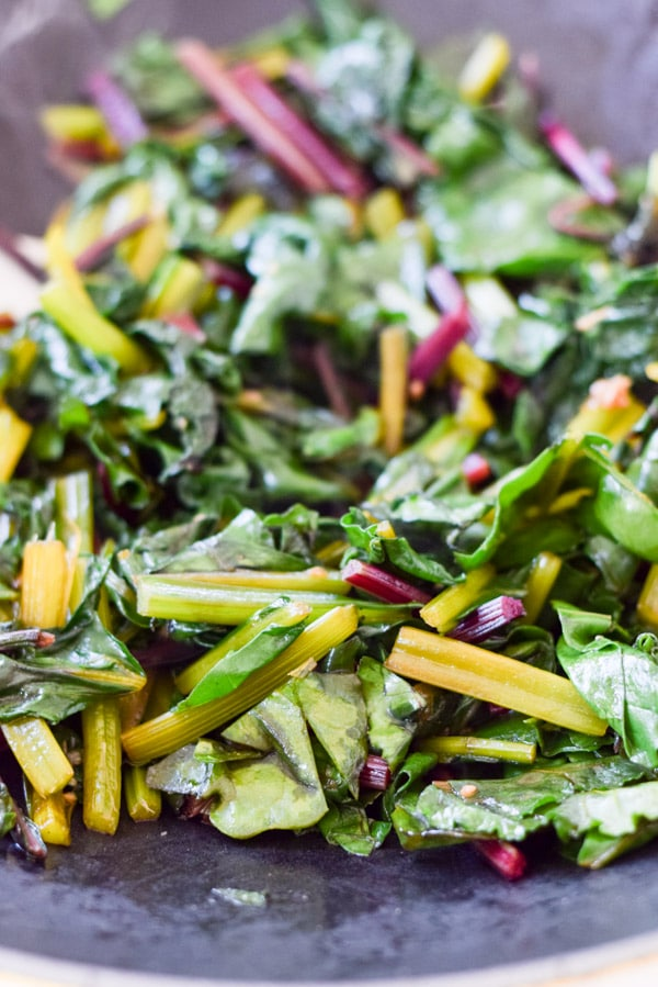 Beet greens starting to be sautéd for the delicious and easy sauteed beet greens