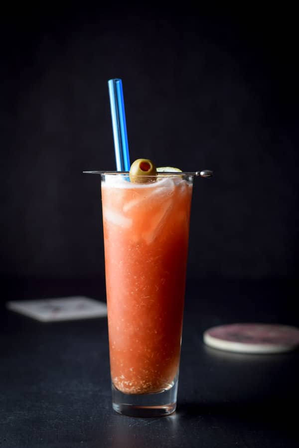 Vertical view of the bloody Mary with a pick with an olive on it
