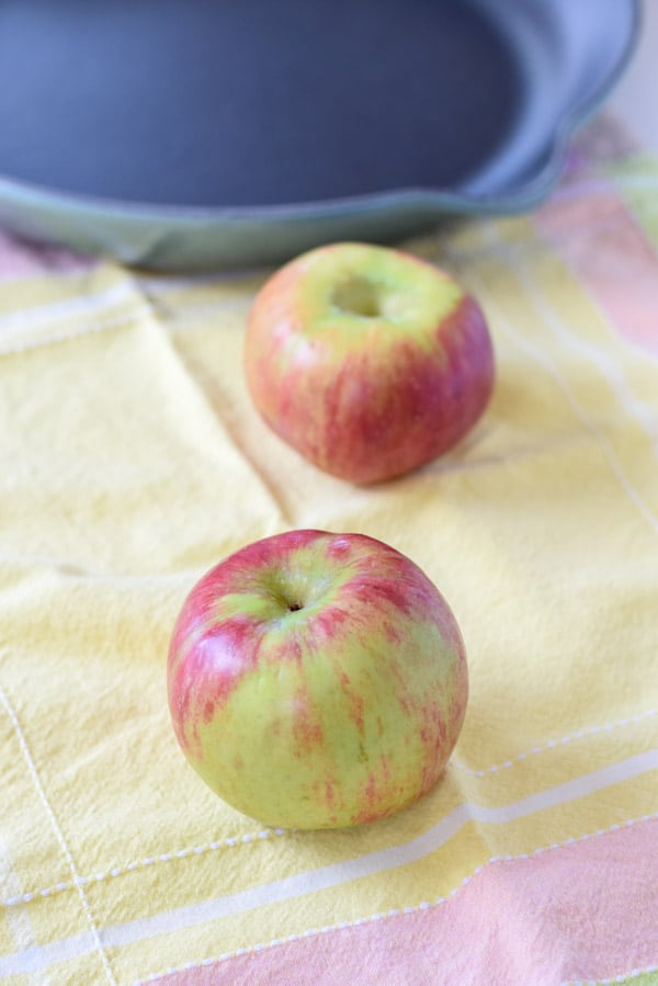 Two apples and a cast iron skillet