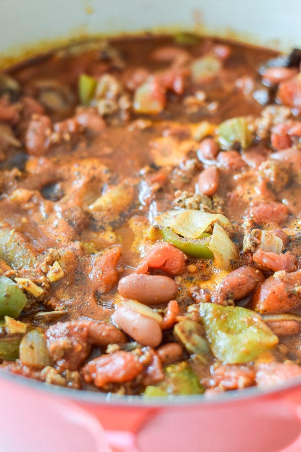 The cooked chili in a red Dutch oven