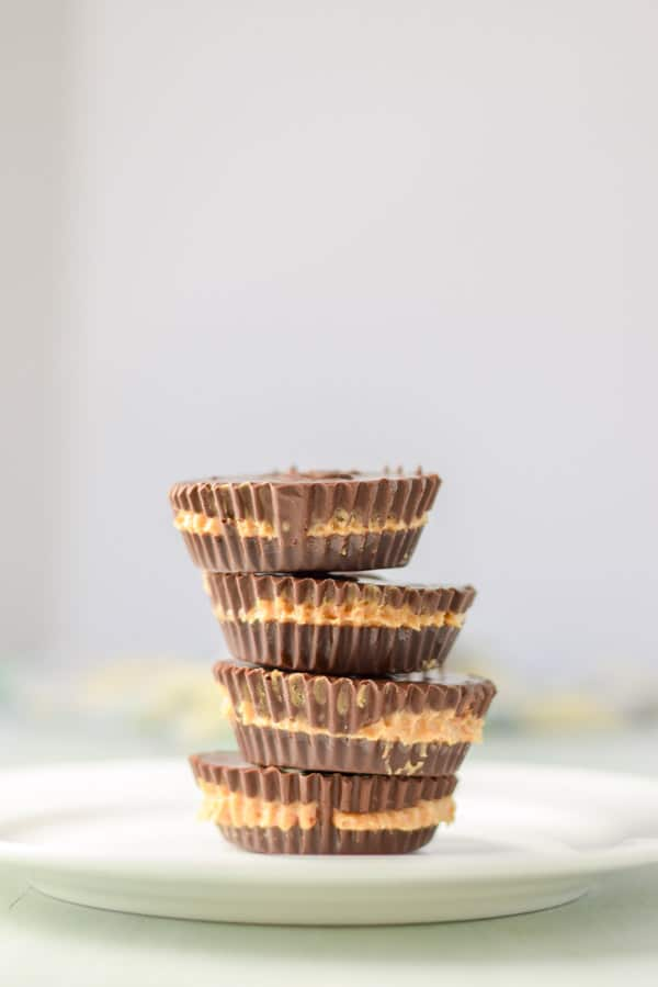 Vertical view of a stack of peanut butter cups on a white plate