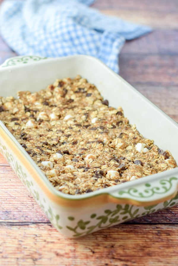 The granola bars packed into a baking dish ready to be baked