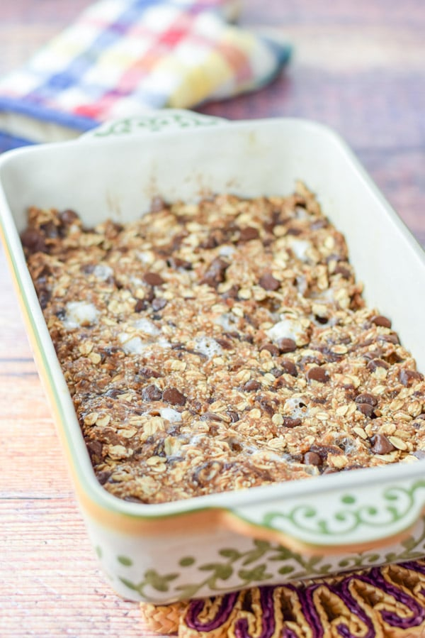 The granola bars out of the oven all melty but still in the baking dish