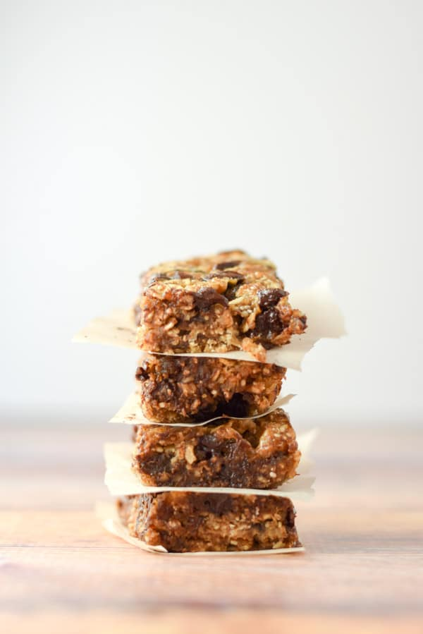 Vertical view of the granola bars stacked with paper between them