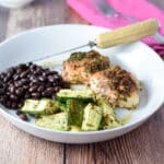 Zucchini, chicken and black beans on a plate - square