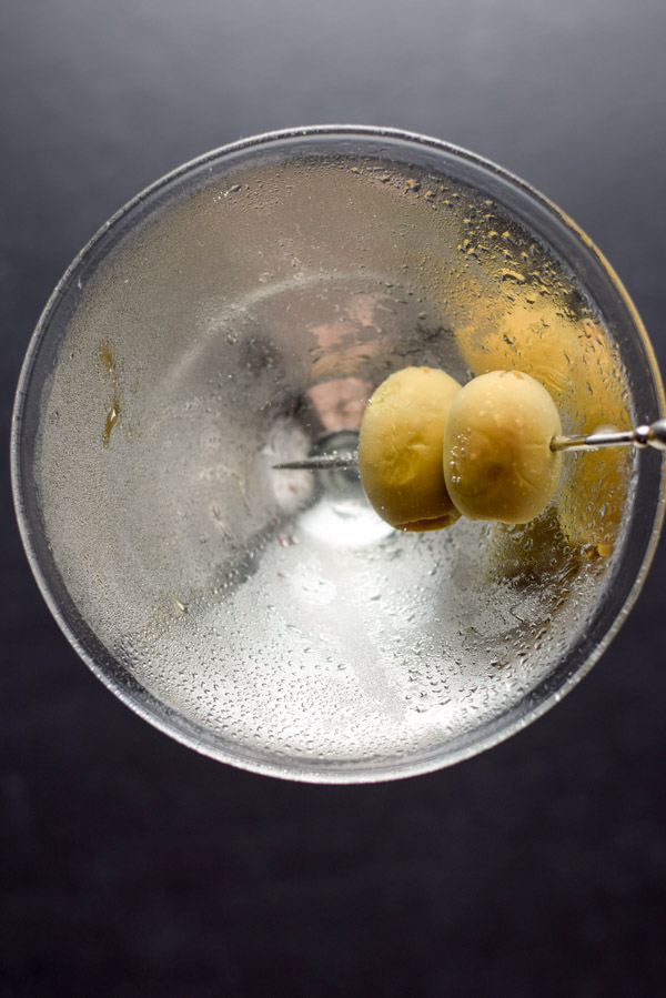 Overhead view for of olives in a martini