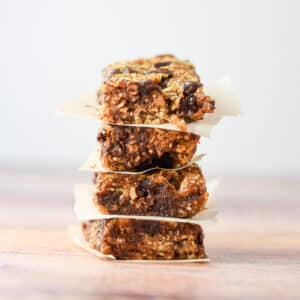 Vertical view of the granola bars stacked with paper between them - square