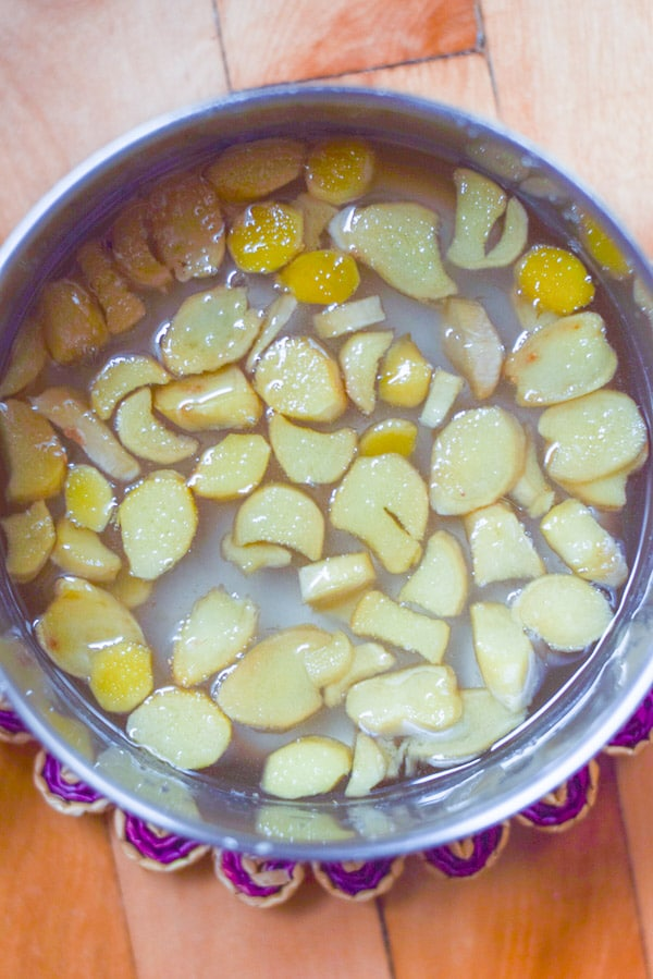 Overhead view of a pan with ginger that's been simmered