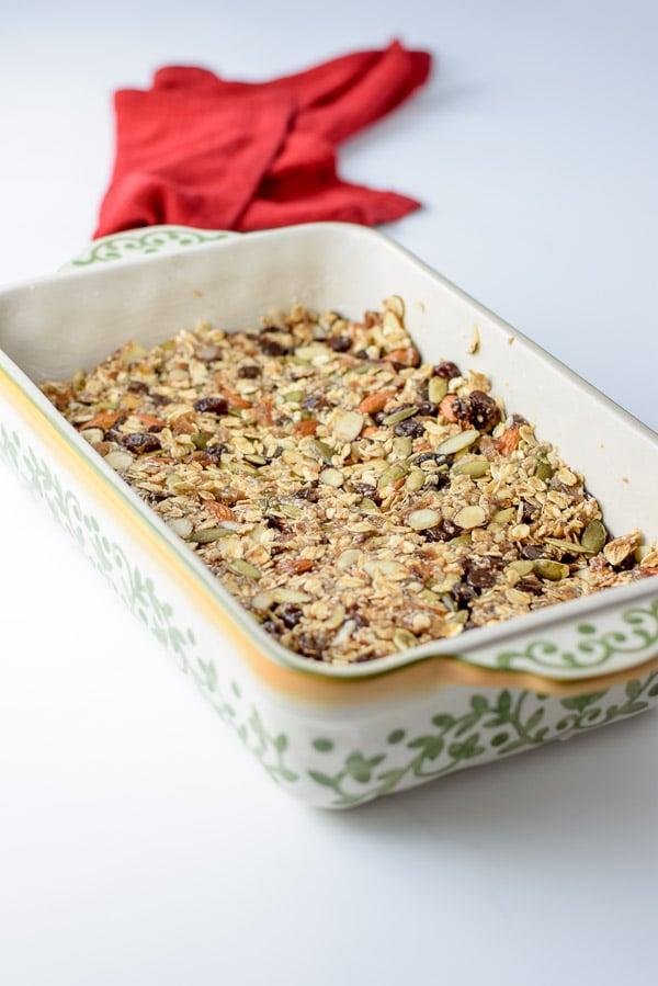 A baking dish with the granola mixture pressed down in it
