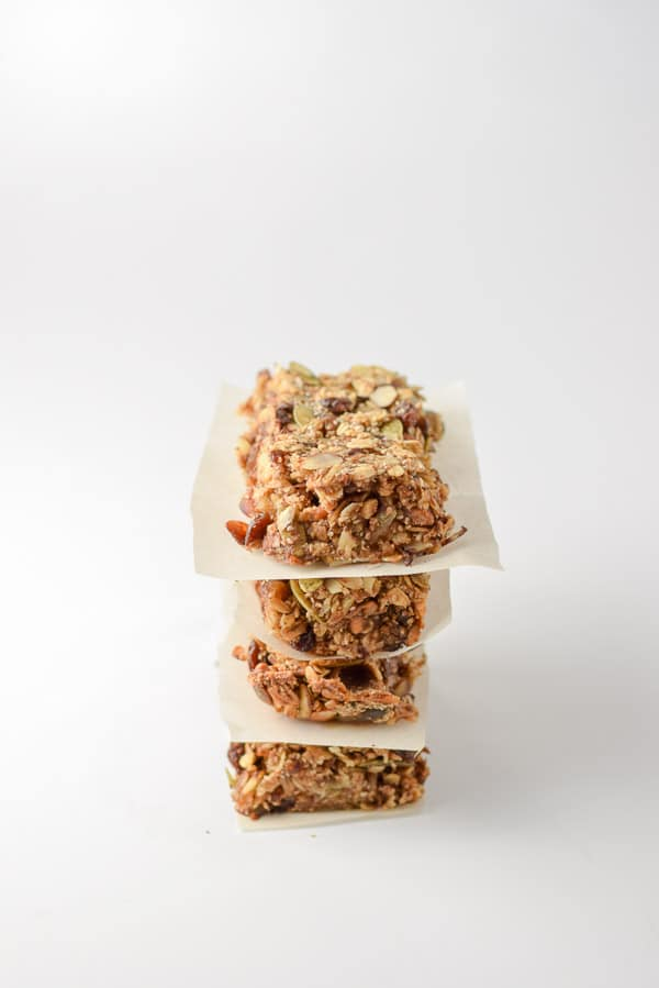 Four bars cut up and stacked with parchment paper between them. They are on a white background