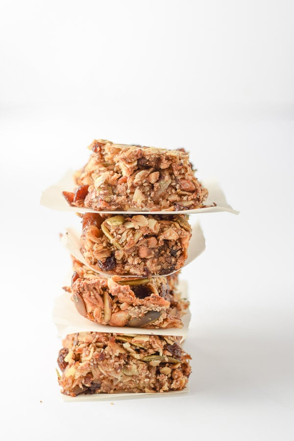 Vertical view of four stacked granola bars with a white background