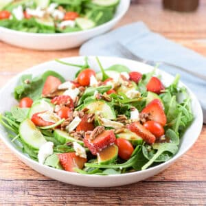 The beautiful strawberry pecan salad with balsamic dressing on top