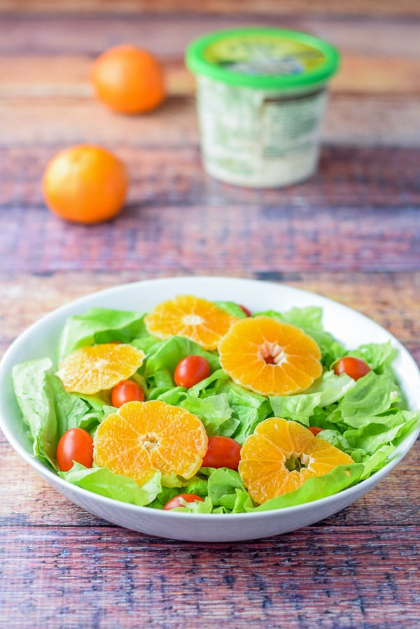 Cut up clementine oranges for the sweet orange scallop salad