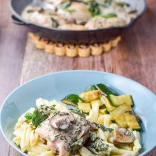 Creamy mushroom and spinach chicken on pasta