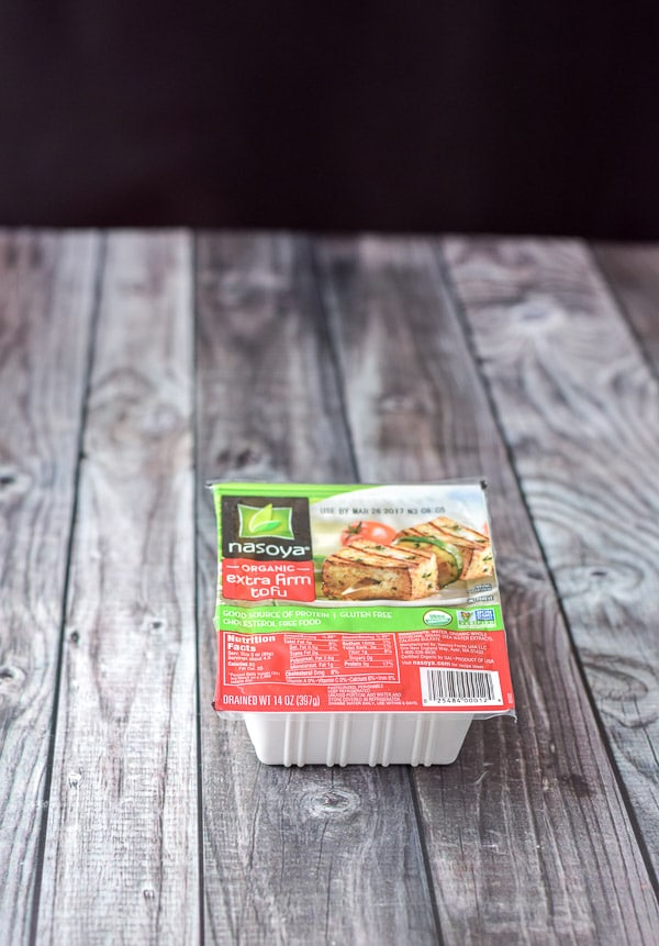 A package of tofu on a grey table