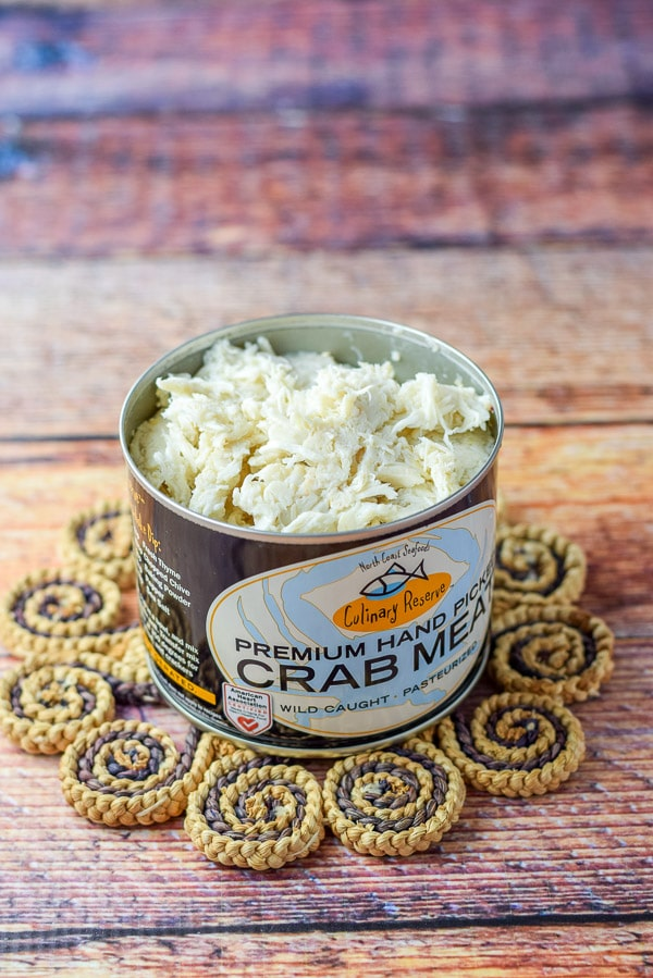 An open can of crab meat on a table